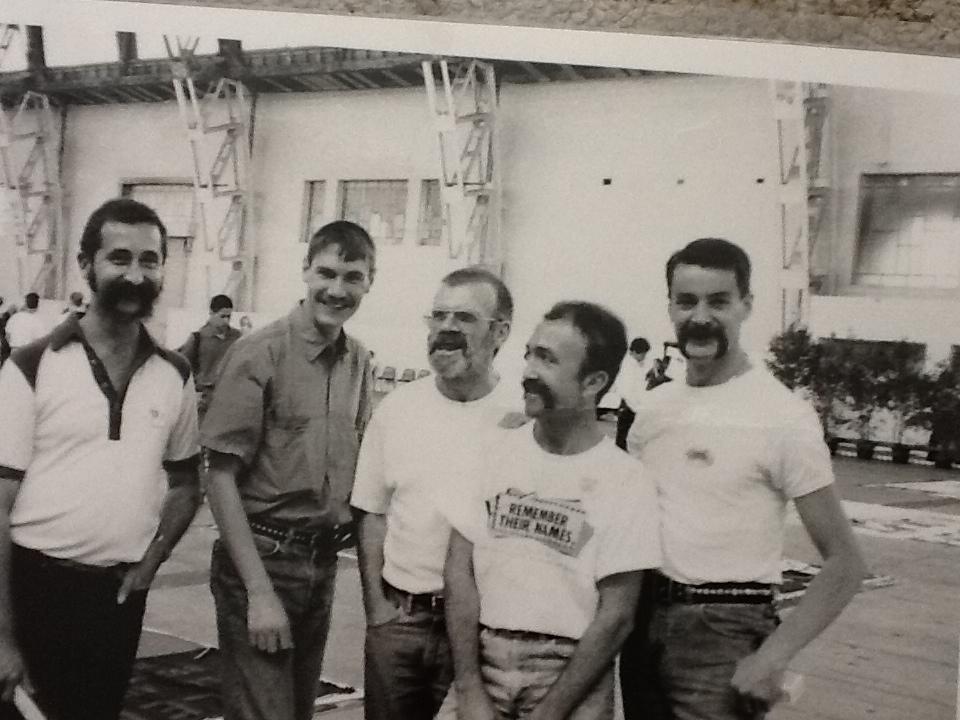 AIDS Quilt unfolding in Government Pavilion, Sydney Showground circa 1988. L-R Peter McCarthy, Peter Gilmore, Bevan, Steve Thompson, Tim Alderman